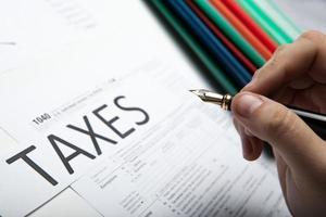 filling tax return on desktop photo