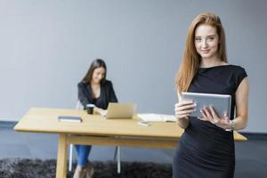 Young woman in the office photo