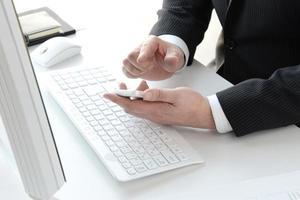 Businessman's hand using smartphone photo