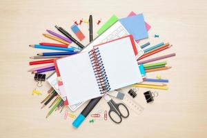 Blank notepad over school and office supplies photo