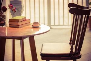Coffee cup with book photo