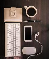 coffee and business card, mouse, keyboard, pen, notebook, smartp