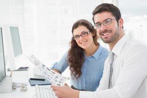Portrait of smiling coworkers brainstorming