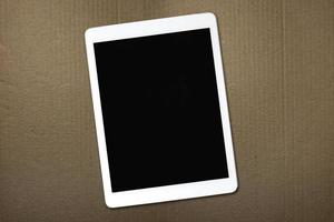 Tablet lying on cardboard