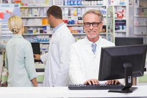 Happy pharmacist looking at camera photo