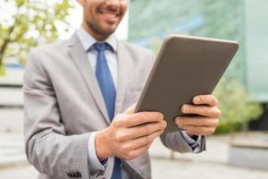 close up of business man with tablet pc in city