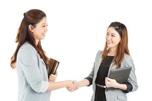 Two beauty businesswomen handshaking photo