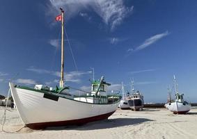 Fishing ship on sandy beach photo