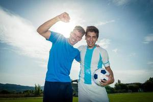 soccer or football players are celebrating goal on stadium photo