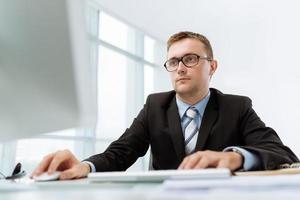 Computing businessman photo