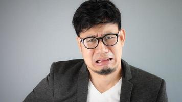 Cryinq Asian Businessman.