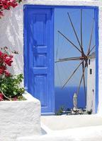 Traditional architecture of Oia village on Santorini island photo