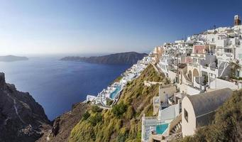 Majestic view of Santorini cliffs in Greece photo