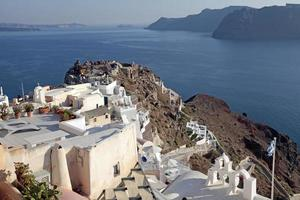 View of Oia town and old castle, Santorini, Greece.