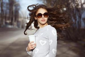 Beautiful brunette girl walking photo