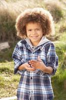 Young Boy Holding Worm Outdoors photo