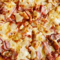 delicious hawaiian rustic style pizza made with fresh pineapples photo