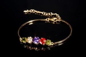 gold bracelet on black background photo