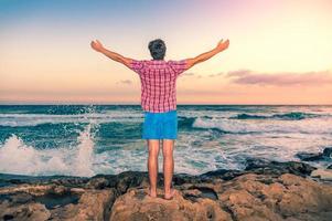 Happy man enjoying freedom outdoors