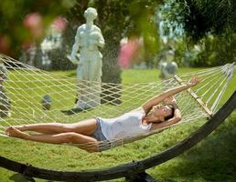 Beautiful girl enjoying on hammock
