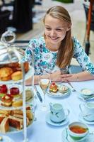 Beautiful young woman enjoying afternoon tea