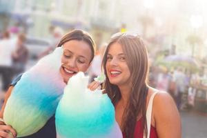 young women eating cotton candy and enjoying