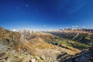 Paragliders enjoying majestic view to Swiss Alps photo