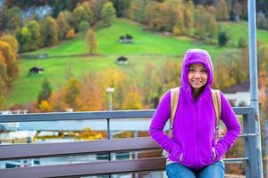 young female tourist enjoy vacation in Switzerland