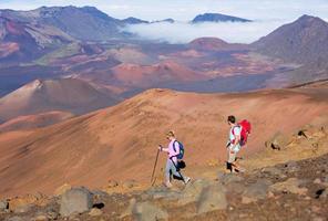 Hikers enjoying walk on amazing mountain trail
