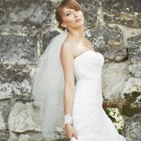 Gorgeous young bride enjoying wedding day. Summertime newlywed. photo