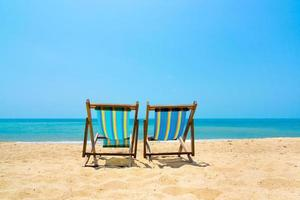 Two lounge chairs on the beach
