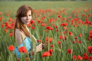 Girl in poppies photo