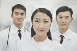 Portrait of Healthcare workers in China, Two Doctors and Nurse photo