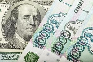 Russian money and one hundred dollars photo