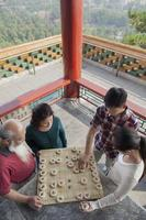 Family Playing Chinese Chess (Xiang Qi)