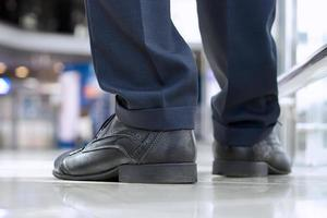 Close-up of businessman feet in  shoes on the floor