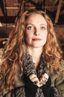 Beautiful woman inside a barn photo