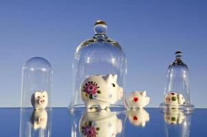 various piggy-banks on mirror