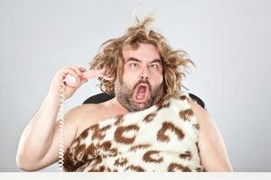prehistoric man on the phone photo