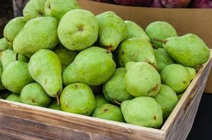 Green bartlett pears for sale at market