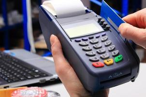 Paying with credit card in an electrical shop, finance concept photo