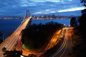 San Francisco Bay Bridge and skyline at night photo