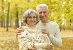 Senior couple in autumn park photo