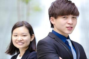 Young female and male Asian business executive smiling portrait