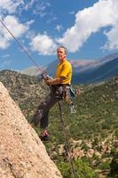 Senior man rappelling in Colorado photo