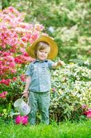 Little gardener in the blooming trees