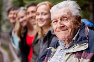An elderly man looking into the camera