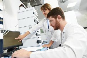 Scientist researcher team works in laboratory