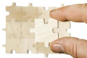 Wooden puzzle on white background.Close up photo