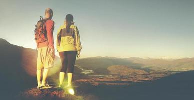 Adventurists Beautiful Sunrise Backpacker Climbing Concept photo